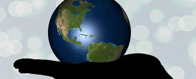 World of Faith - Hand holding a globe.